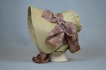 Bonnet, cream and ivory silk with deep brim and salmon ribbon, c. 1830s-1840s, full side view by Irma G. Bowen Historic Clothing Collection