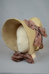 Bonnet, cream and ivory silk with deep brim and salmon ribbon, c. 1830s-1840s, side-front view by Irma G. Bowen Historic Clothing Collection
