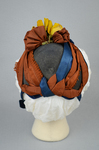 Bonnet, black straw capote trimmed with blue velvet, silk ribbons in blue and dark orange, and artificial flowers, 1880s, back view by Irma G. Bowen Historic Clothing Collection
