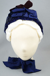 Bonnet, blue felt capote with blue velvet, blue feather trim, and velvet ribbon in blue and burgundy, 1880s, front view by Irma G. Bowen Historic Clothing Collection