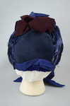Bonnet, blue felt capote with blue velvet, blue feather trim, and velvet ribbon in blue and burgundy, 1880s, back view by Irma G. Bowen Historic Clothing Collection