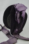 Bonnet, deep purple velvet with a peaked brim and purple silk ribbons, mid-1880s, side view by Irma G. Bowen Historic Clothing Collection