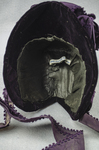 Bonnet, deep purple velvet with a peaked brim and purple silk ribbons, mid-1880s, interior view by Irma G. Bowen Historic Clothing Collection