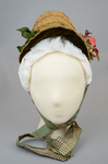 Bonnet, natural straw woven into lace with pink roses and plaid ribbon ties, 1880s, front view by Irma G. Bowen Historic Clothing Collection