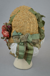 Bonnet, natural straw woven into lace with pink roses and plaid ribbon ties, 1880s, back view by Irma G. Bowen Historic Clothing Collection
