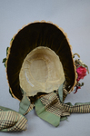 Bonnet, natural straw woven into lace with pink roses and plaid ribbon ties, 1880s, interior view by Irma G. Bowen Historic Clothing Collection