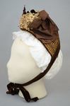 Bonnet, straw with brown velvet, brown grosgrain ribbons, and velvet chrysanthemums, 1880s, side view by Irma G. Bowen Historic Clothing Collection
