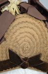 Bonnet, straw with brown velvet, brown grosgrain ribbons, and velvet chrysanthemums, 1880s, back detail by Irma G. Bowen Historic Clothing Collection