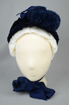 Bonnet, blue straw capote with velvet trim and feather puffs, 1870s-1880s, front view by Irma G. Bowen Historic Clothing Collection