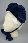 Bonnet, blue straw capote with velvet trim and feather puffs, 1870s-1880s, left side view by Irma G. Bowen Historic Clothing Collection