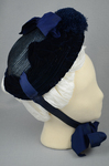 Bonnet, blue straw capote with velvet trim and feather puffs, 1870s-1880s, right side view by Irma G. Bowen Historic Clothing Collection