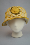 Cloche, yellow silk with raffia accents, 1920s, front view by Irma G. Bowen Historic Clothing Collection