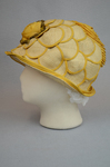 Cloche, yellow silk with raffia accents, 1920s, left side view by Irma G. Bowen Historic Clothing Collection