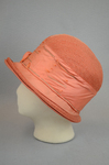 Cloche, salmon raffia, 1920s, left side view by Irma G. Bowen Historic Clothing Collection