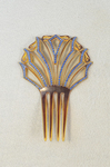 Comb, amber with blue rhinestones, early 20th century by Irma G. Bowen Historic Clothing Collection