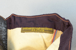 Boots, purple faille high-button, 1880s-1900s, detail of fabric label by Irma G. Bowen Historic Clothing Collection