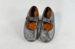 Children's shoes, black leather with strap, early 20th century, front view by Irma G. Bowen Historic Clothing Collection