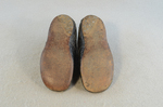 Children's shoes, black leather with strap, early 20th century, top and sole view by Irma G. Bowen Historic Clothing Collection