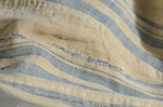 Dress, blue and white striped linen, homespun, c. 1800, interior, detail of mended rip by Irma G. Bowen Historic Clothing Collection