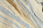 Dress, blue and white striped linen, homespun, c. 1800, exterior, detail of mended rip by Irma G. Bowen Historic Clothing Collection