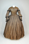 Dress, brown silk with black fringe trim, 1853-1863, front view by Irma G. Bowen Historic Clothing Collection