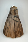 Dress, brown silk with black fringe trim, 1853-1863, side view by Irma G. Bowen Historic Clothing Collection