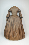 Dress, brown silk with black fringe trim, 1853-1863, back view by Irma G. Bowen Historic Clothing Collection
