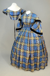 Dress, blue, yellow, and black plaid silk, with both day and evening bodices, 1860s, front-side view by Irma G. Bowen Historic Clothing Collection
