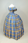 Dress, blue, yellow, and black plaid silk, with evening bodice, 1860s, side view by Irma G. Bowen Historic Clothing Collection