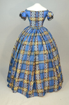 Dress, blue, yellow, and black plaid silk, with evening bodice, 1860s, back view by Irma G. Bowen Historic Clothing Collection