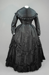 Dress, black plain weave silk with ruffles, c. 1870, front view by Irma G. Bowen Historic Clothing Collection