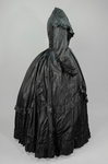 Dress, black plain weave silk with ruffles, c. 1870, side view by Irma G. Bowen Historic Clothing Collection