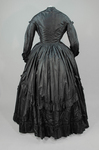 Dress, black plain weave silk with ruffles, c. 1870, back view by Irma G. Bowen Historic Clothing Collection