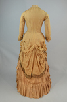 Dress, amber silk taffeta with chenille-fringed barege overdress, c. 1880, back view by Irma G. Bowen Historic Clothing Collection