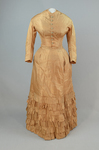 Dress, amber silk taffeta with chenille-fringed barege overdress, c. 1880, underdress by Irma G. Bowen Historic Clothing Collection