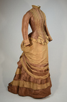 Dress, brown and tan silk taffeta with cuirass bodice and bustle, c. 1883, side view by Irma G. Bowen Historic Clothing Collection