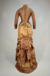 Dress, brown and tan silk taffeta with cuirass bodice and bustle, c. 1883, back view by Irma G. Bowen Historic Clothing Collection