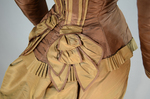 Dress, brown and tan silk taffeta with cuirass bodice and bustle, c. 1883, detail of peplum by Irma G. Bowen Historic Clothing Collection