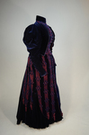 Dress, blue velvet and blue voided velvet on a red ground, c. 1892, side view by Irma G. Bowen Historic Clothing Collection