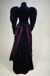 Dress, blue velvet and blue voided velvet on a red ground, c. 1892, back view by Irma G. Bowen Historic Clothing Collection