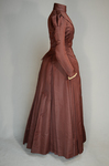 Wedding dress, maroon silk faille with sleeve puffs, 1893, side view by Irma G. Bowen Historic Clothing Collection