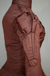 Wedding dress, maroon silk faille with sleeve puffs, 1893, detail of sleeve puff by Irma G. Bowen Historic Clothing Collection