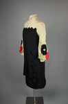 Dress, black silk charmeuse with cream silk yoke and sleeves, 1928, quarter view by Irma G. Bowen Historic Clothing Collection