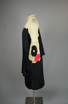 Dress, black silk charmeuse with cream silk yoke and sleeves, 1928, side view by Irma G. Bowen Historic Clothing Collection