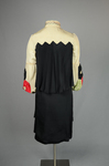 Dress, black silk charmeuse with cream silk yoke and sleeves, 1928, back view by Irma G. Bowen Historic Clothing Collection