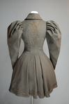 Coat, brown wool with leg-of-mutton sleeves and appliqué, 1894, back view by Irma G. Bowen Historic Clothing Collection
