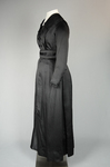 Dress, black ribbed double-faced satin trimmed with reverse side, 1910-1915, side view by Irma G. Bowen Historic Clothing Collection