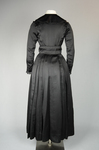 Dress, black ribbed double-faced satin trimmed with reverse side, 1910-1915, back view by Irma G. Bowen Historic Clothing Collection