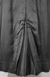 Dress, black ribbed double-faced satin trimmed with reverse side, 1910-1915, detail of skirt by Irma G. Bowen Historic Clothing Collection