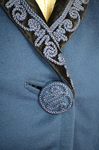 Wedding suit, blue wool with cord-work 1909, detail of button and collar by Irma G. Bowen Historic Clothing Collection